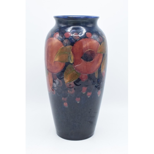 86A - Moorcroft tall tubular vase in the Pomegranate design. There has been some professional restoration ...