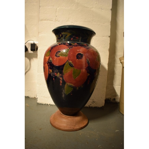 86B - Impressive Moorcroft bulbous vase in the Pomegranate design mounted on a newer wooden base. Standing...