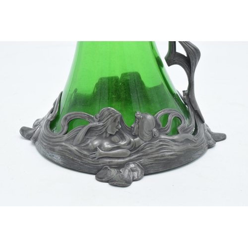 219A - A WMF art nouveau pewter claret jug with threaded stopper, tapering green glass body and designed ma...