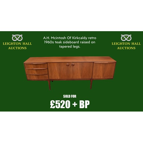 A.H. Mcintosh Of Kirkcaldy retro 1960s teak sideboard raised on tapered legs. Approx 208 x 46 x 76cm. Generally in good tidy condition with some age related wear and tear to includes scratches scuffs etc. Observe the photos for further information.