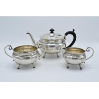 Silver 3-piece tea set to consist of the teapot, milk and sugar bowl (3). Hallmarked for Birmingham 1927. 936 grams gross weight. Generally in good condition with some inscriptions and also denting / feet pushed in etc.