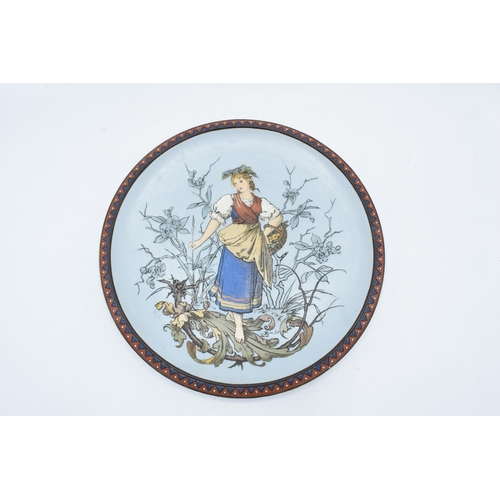4 - Late 19th century Mettlach (Villeroy and Boch) wall charger after C. Warth decorated with a lady hol...
