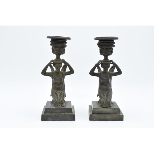 A pair of 19th century Grand Tour Bronze candlesticks depicting ladies with wings holding an urn on their head, circa 1830s. In good condition with no obvious damage or restoration. The candle holder is detachable on both. 18.5cm tall.