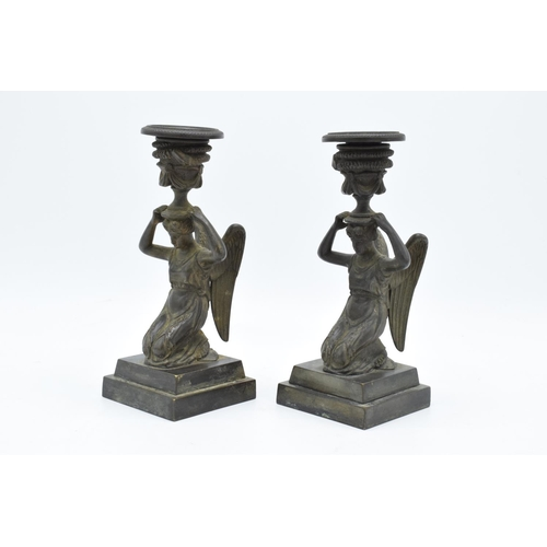 5 - A pair of 19th century Grand Tour Bronze candlesticks depicting ladies with wings holding an urn on ...