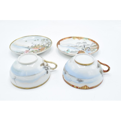 21 - A pair of Japanese export ware tea cups and saucers (2 duos).