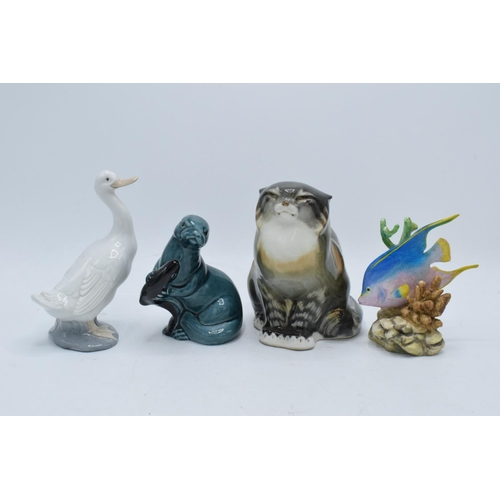25 - A collection of pottery to include a USSR Cat 2003, Poole pottery Otter, Nao duck and a Royal Worces...