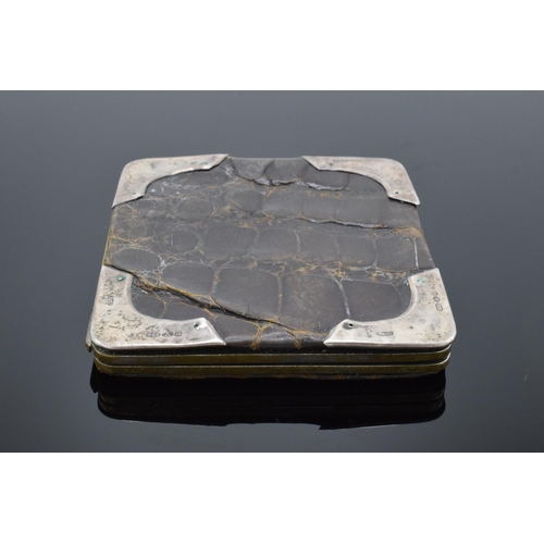 64 - Hallmarked silver mounted and crocodile wallet: Shows multiple London import hallmarks.  Some creasi...