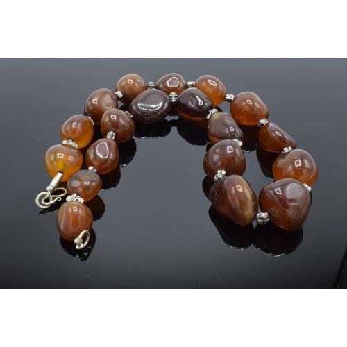 65 - Large & heavy string of semi precious gemstone agate (or similar ) beads.