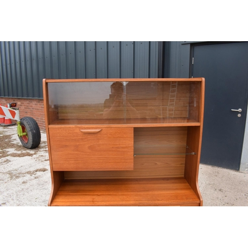 117 - A good mid century teak or similar wood cabinet / sideboard with glass sliding doors and drawers etc...