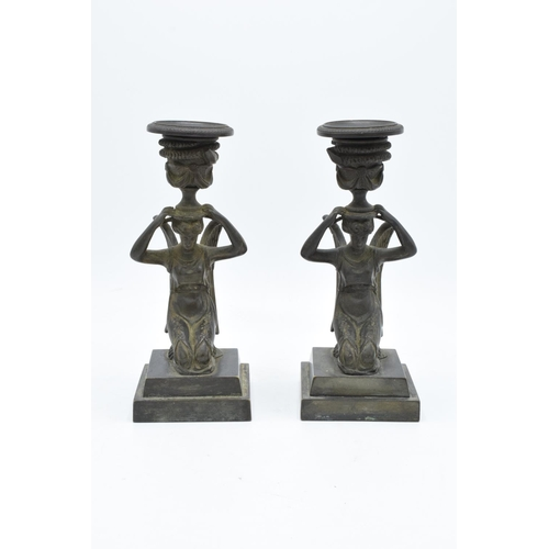 170 - A pair of 19th century Grand Tour Bronze candlesticks depicting ladies with wings holding an urn on ...