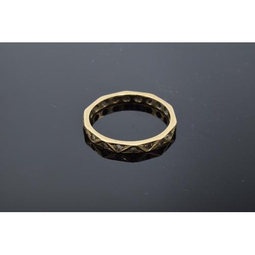 475 - Three 9ct gold rings – white stone cluster UK size O, single white stone size N/O and eternity size ...