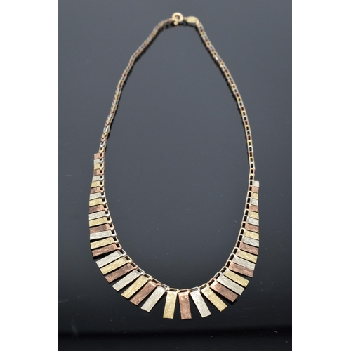 537 - 9ct tri-colour gold fringe necklace, made in Italy with UK import marks. 7.5 grams. 43cm long.