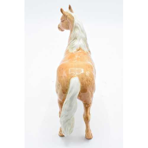 151 - Beswick Pinto pony in Palomino colourway 1373. 17cm tall. In good condition with no obvious damage o...