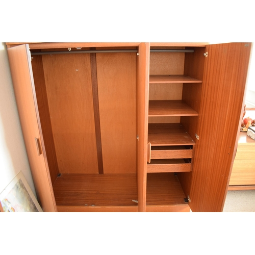 284 - Mid century / retro E Gomme High Wycombe G-Plan triple wardrobe unit. 145 x 61 x 204cm tall. Sold in...