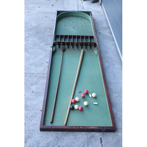 285 - A 19th century folding table-top bagatelle in a mahogany case with green felt interior by Thurston a...