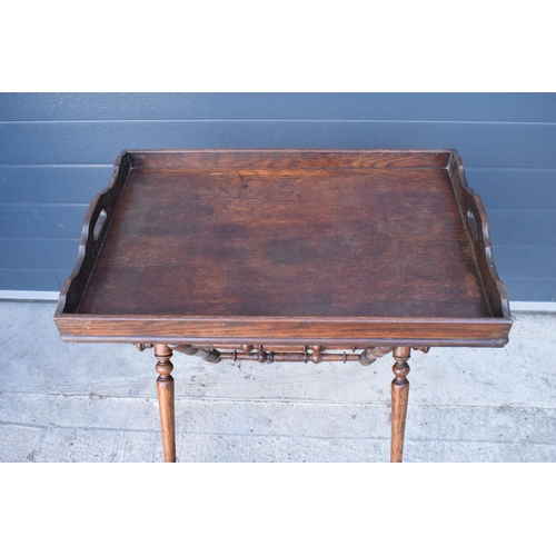 150A - A good Victorian oak butlers tray of typical form, the shaped rectangular tray raised upon a turned ...