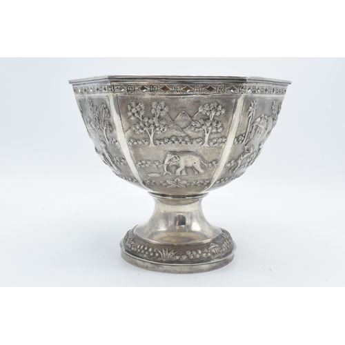 198 - A late 19th / early 20th century Indian silver pedestal bowl with embossed decoration depicting vill...