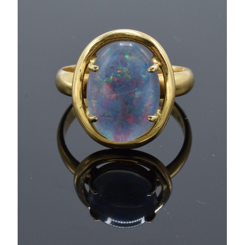 200 - 18ct gold ring set with a large opal stone. UK size Q/R. Total weight 5.8 grams.