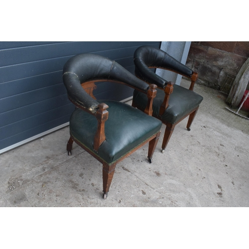299 - A pair of 19th century upholstered Captain's Bow or similar smokers / library chairs. In good struct...