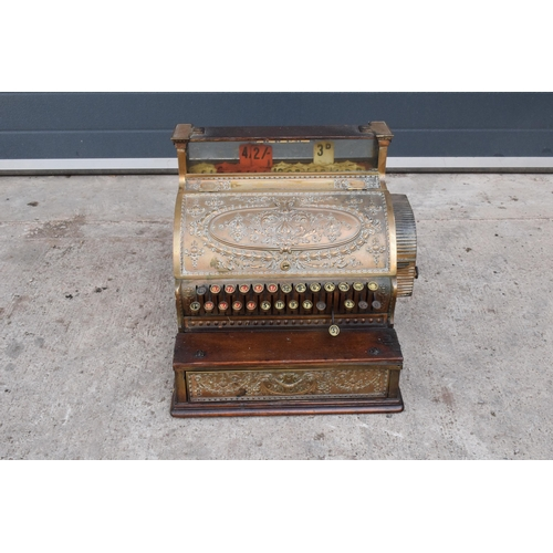301 - A 19th / 20th century cash register by National Cash Register Co, Dayton, Ohio, USA. Size 36 1/4. In...