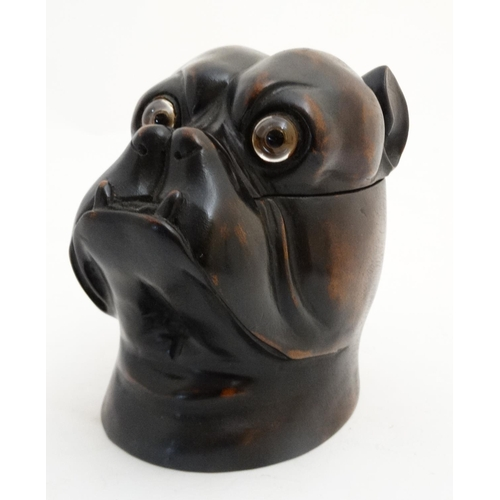 107 - Black Forest : a 20 thC tobacco jar in the form of a Boxer Dog head having glass eyes.5 3/4'' high...