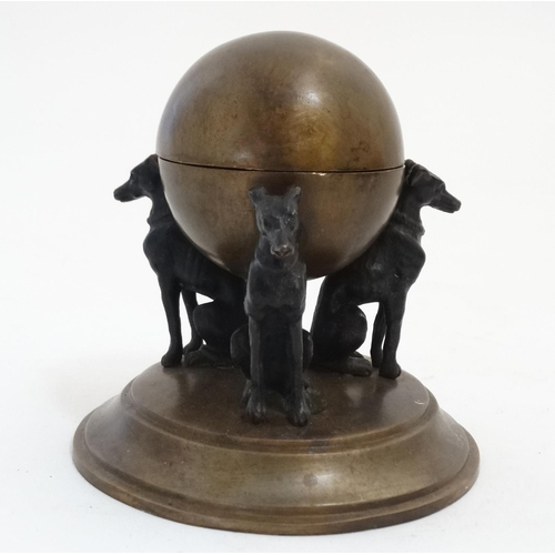 113 - A 21stC after the Regency, cast bronze inkwell depicting three greyhounds suspending a lidded sphere...