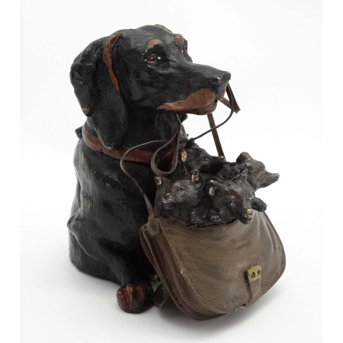 114 - A late 20thC decorative cold painted bronze novelty inkwell formed as a dog holding a bag of puppies...