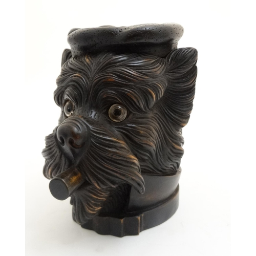 118 - Black Forest : a 20 thC carved wooden novelty Tobacco jar in the form of a Cigar smoking and tassel ...