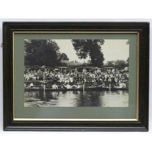 144 - Boating - A c1920s framed black and white photograph from the Cambridge Lent Regatta showing spectat...