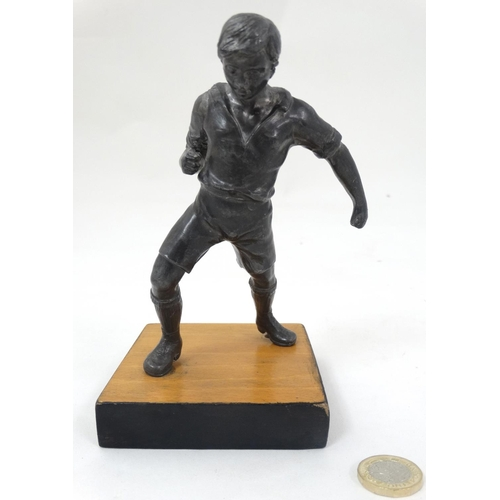 155 - A mid 20thC cast metal model of a footballer? Probably Russian. On wooden base. The whole 6 3/4'' hi...