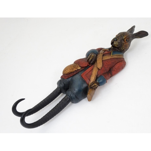 83 - A 21stC wall mounted double coat hook formed as a rabbit and decorated in polychrome. 19'' high....