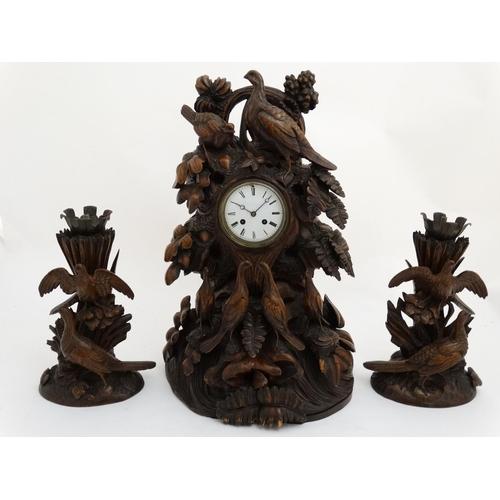 85 - Impressive 19thC Black Forest clock and garnitures :   A superb Black Forest carved wooden clock wit...