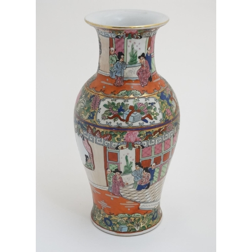 10 - A Chinese famille rose flared rim vase in a Cantonese style , the body decorated with exotic birds a...