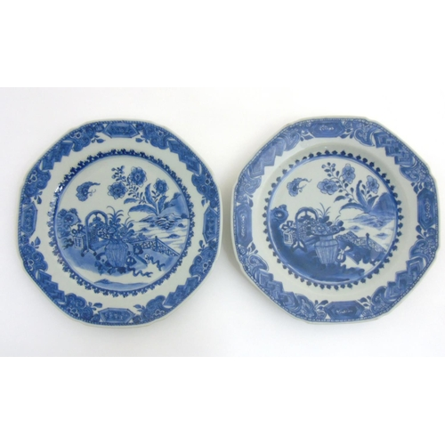 29 - Two Chinese blue and white octagonal plates with canted corners, having hand painted designs of flow...