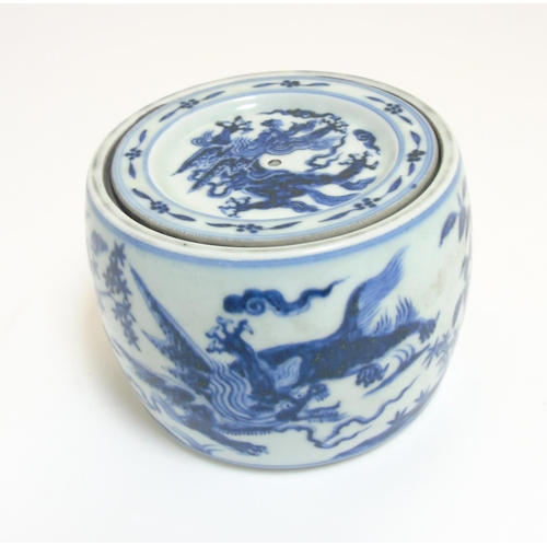 39 - A Chinese blue and white cricket jar and cover decorated in underglaze blue depicting 4 clawed drago...