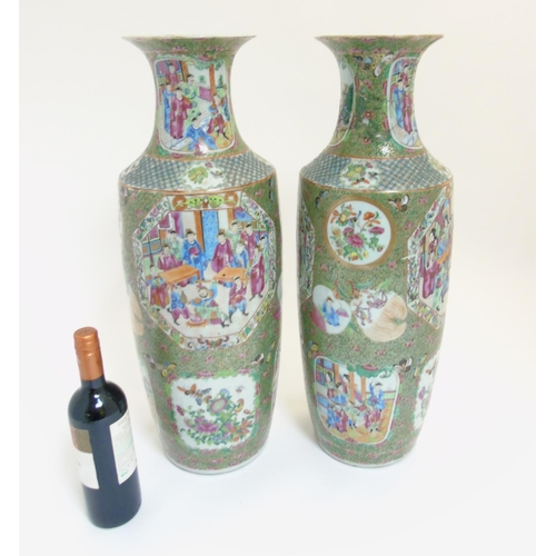 48 - A pair of large Chinese Cantonese / Rose Medallion baluster vases, each decorated with various figur...