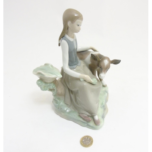 54 - A Lladro 'Girl with Calf'  figurine, makers mark to base, 8 1/2'' high...