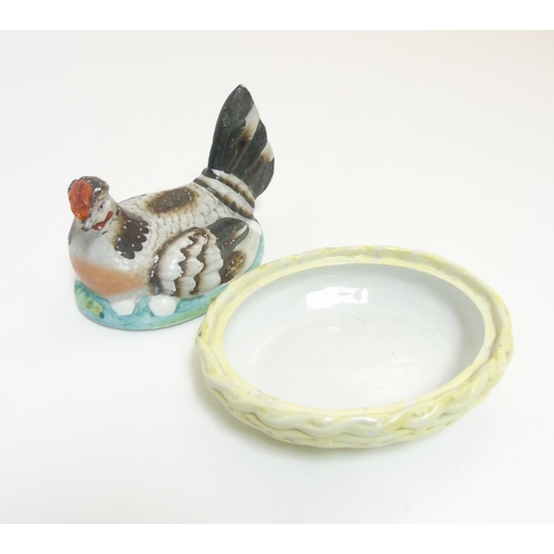 59 - A 19thC Staffordshire hen on nest tureen with yellow basket, 7'' wide...