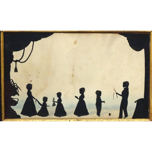 12 - Early family cut silhouette conversation piece, c1820, attributed to Auguste Edouart, with gilt high...