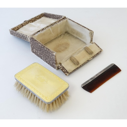 22 - A silver backed hairbrush of rectangular form with yellow guilloché enamel decoration  hallmarked Bi...