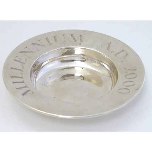 23 - A silver commemorative dish ' Millennium A.D 2000'  hallmarked London 2000 maker PS. 4 1/2'' wide (9...