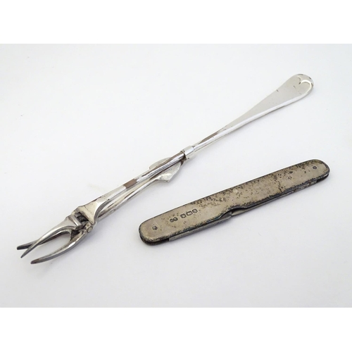 27 - A silver ' J.M. Wade's patent ' pickle fork hallmarked Sheffield 1898 maker Joseph Rodgers & Sons. T...