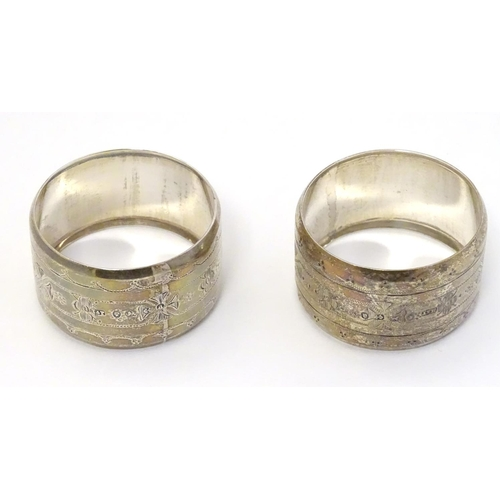 28 - A pair of Victorian silver napkin rings with engraved decoration hallmarked Birmingham 1875 maker Hi...