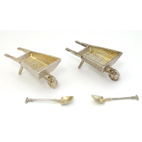 31 - A pair of novelty silver table salts formed as garden wheelbarrows Hallmarked London 1998 maker CCP....