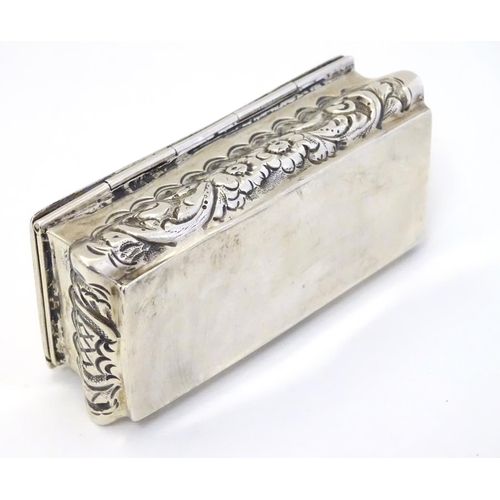 32 - A silver dressing table box with hinge lid and embossed decoration. Hallmarked Birmingham 1901 maker...
