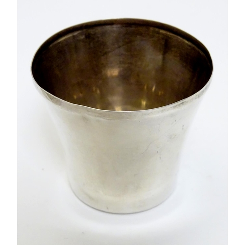 33 - A silver tot cup hallmarked Birmingham 1975 maker ESC. 1 3/4'' high. Together with a silver pill box...