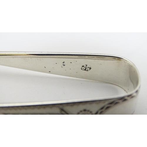 34 - Small silver sugar tongs: 1 x hallmarked Birmingham 1924 maker Robert Chandler,  1 x London  1905 ma...