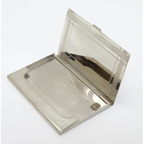 42 - A silver plate card case 3 3/4'' x 2 1/'' x 1/4''...