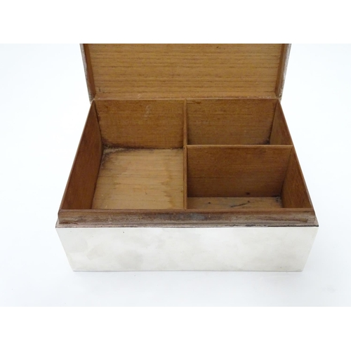 45 - A table top cigarette / cigar box with wood lined 3-sectional interior. Hallmarked Chester c.1919 ma...