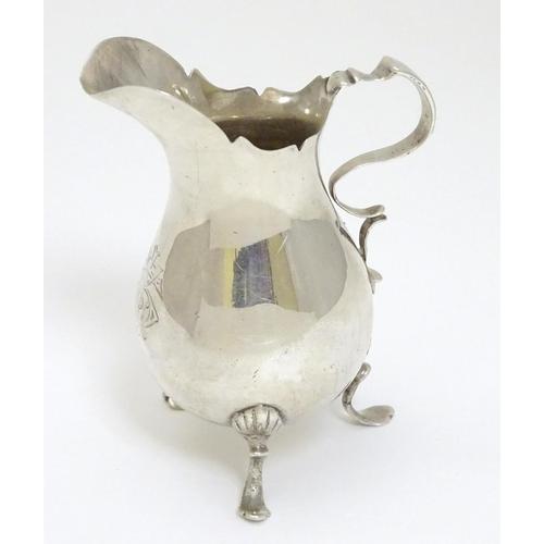 47 - A silver cream jug, hallmarked Birmingham 1899 maker John Edward Wilmot 4'' high (70g)...